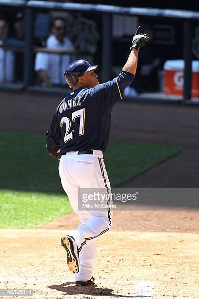 Carlos Gomez of the Milwaukee Brewers signals to the fans after hitting a solo home run in the bottom of the 2nd inning against the Toronto Blue Jays...