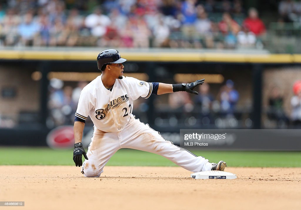 Carlos Gomez #27 of the Milwaukee Brewers slides into second base during the game against the Cincinnati Reds at Miller Park on Wednesday, August 8, 2012 in Milwaukee, Wisconsin.