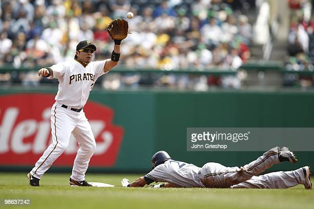 Carlos Gomez of the Milwaukee Brewers steals second base ahead of the tag of Akinori Iwamura of the Pittsburgh Pirates during the game between the...