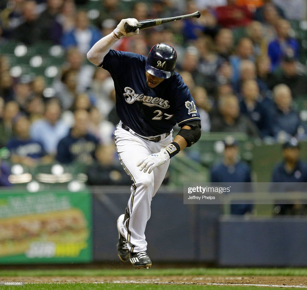 Carlos Gomez #27 of the Milwaukee Brewers throws his bat after flying out against the Colorado Rockies in the fifth inning at Miller Park on April 8, 2015 in Milwaukee, Wisconsin.