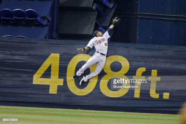 July 7: Carlos Gomez of the Minnesota Twins catches the ball to steal a grand slam home run away from Alex Rodriguez of the New York Yankees on July...