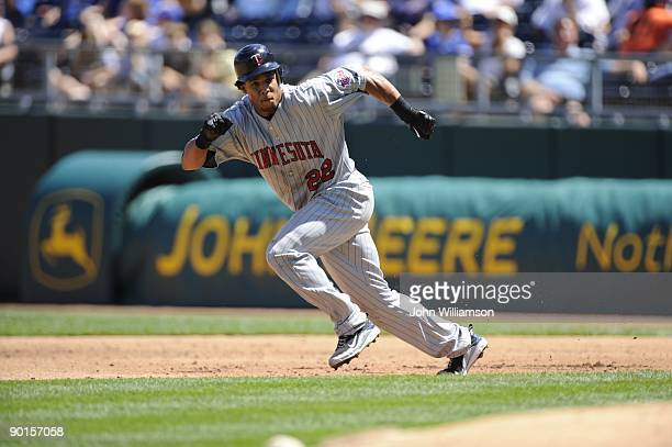 Carlos Gomez of the Minnesota Twins runs on the pitch from first base during the game against the Kansas City Royals at Kauffman Stadium in Kansas...