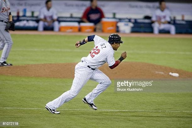 Carlos Gomez of the Minnesota Twins runs to second against the Detroit Tigers at the Metrodome in Minneapolis, Minnesota on May 4, 2008. The Twins...