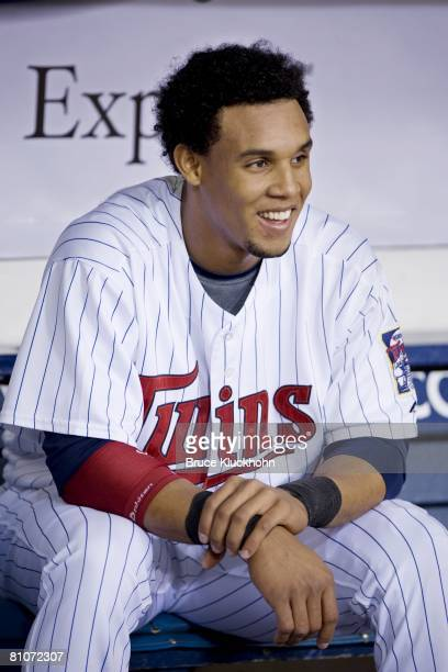 Carlos Gomez of the Minnesota Twins smiles before the game against the Detroit Tigers at the Metrodome in Minneapolis, Minnesota on May 4, 2008. The...