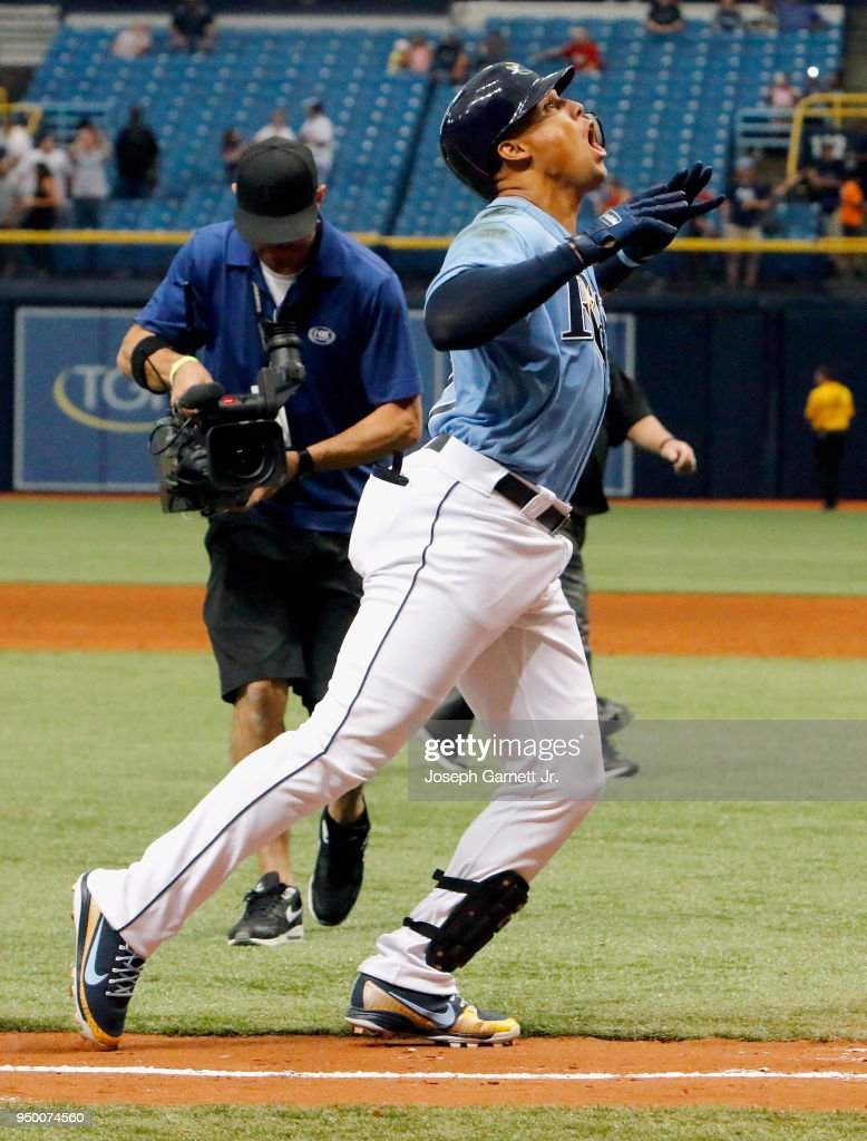 Carlos Gomez #27 of the Tampa Bay Rays celebrates as he approaches home plate after hitting a two-run home run driving in Rob Refsnyder, winning the game against the Minnesota Twins at Tropicana Field on April 22, 2018 in St. Petersburg, Florida.