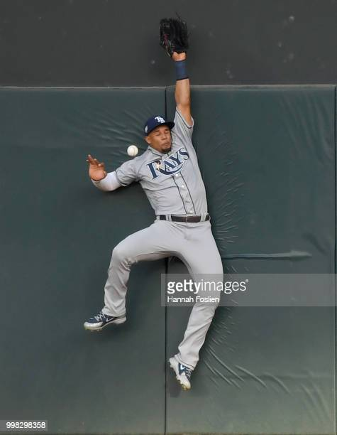 Carlos Gomez of the Tampa Bay Rays is unable to catch an RBI triple hit by Jorge Polanco of the Minnesota Twins during the first inning of the game...