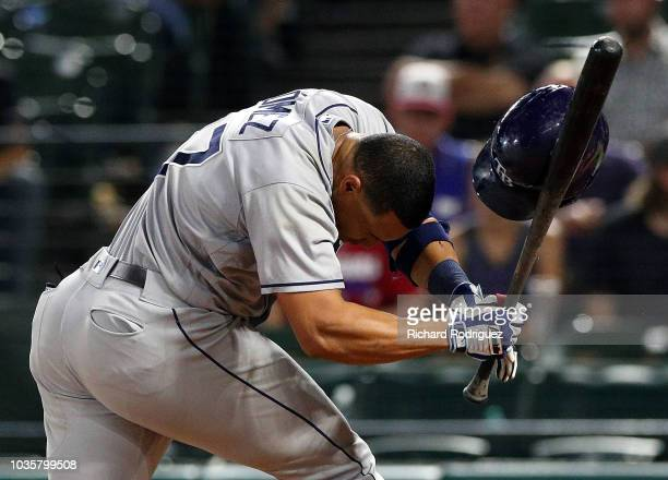 Carlos Gomez of the Tampa Bay Rays reels after beign hit by a pitch in the ninth inning against the Texas Rangers at Globe Life Park in Arlington on...