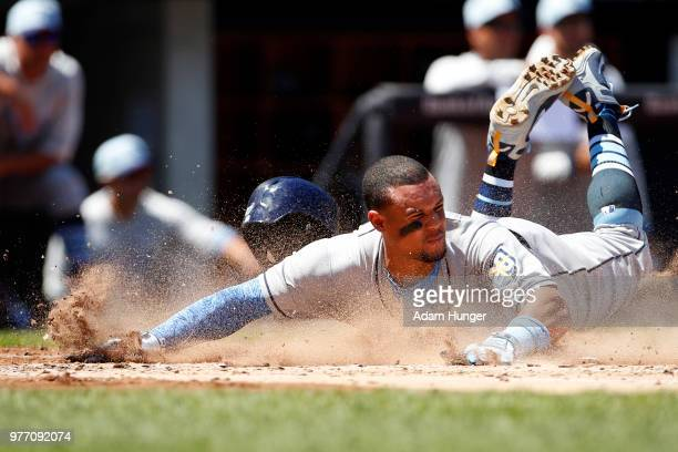 Carlos Gomez of the Tampa Bay Rays scores a run against the New York Yankees during the second inning at Yankee Stadium on June 17 2018 in the Bronx...