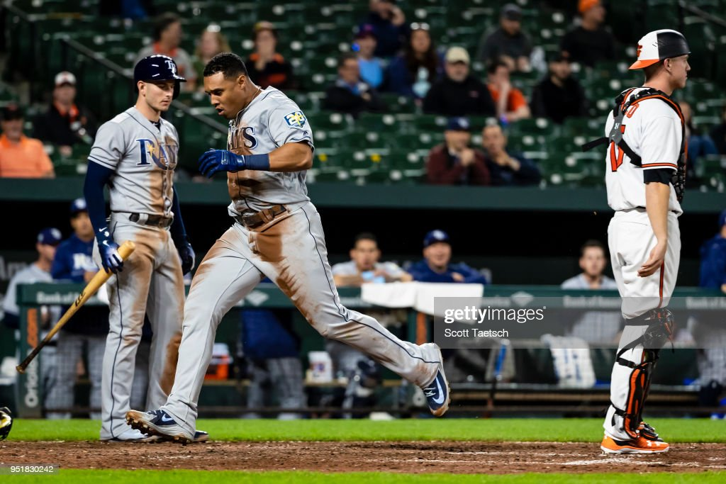 Carlos Gomez #27 of the Tampa Bay Rays scores on an error during the ninth inning against the Baltimore Orioles at Oriole Park at Camden Yards on April 26, 2018 in Baltimore, Maryland.