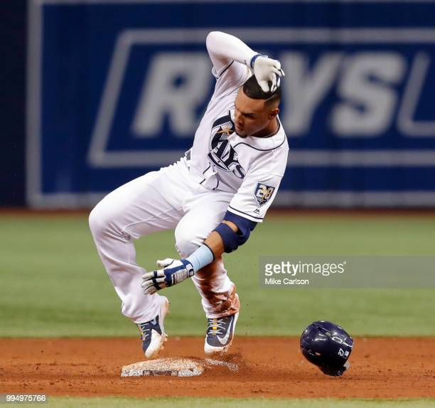 Carlos Gomez of the Tampa Bay Rays slides into second with a double in the third inning of a baseball game against the Detroit Tigers at Tropicana...
