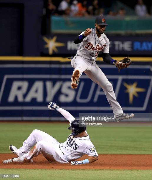 Carlos Gomez of the Tampa Bay Rays steals second as Niko Goodrum of the Detroit Tigers fields the throw in the third inning during a game at...
