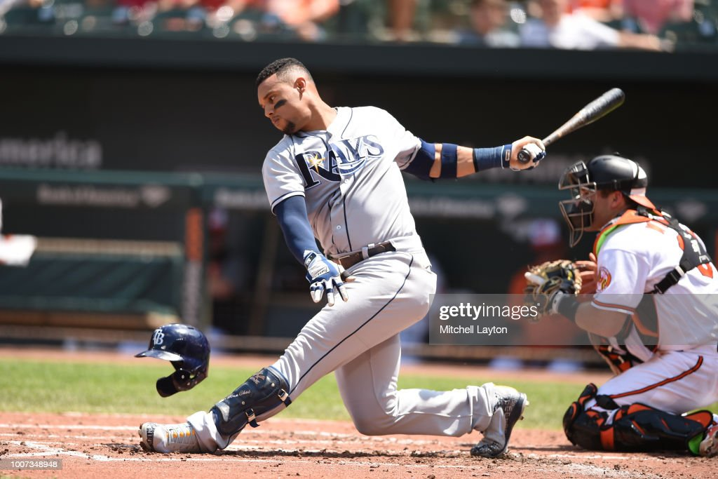 Carlos Gomez #27 of the Tampa Bay Rays strikes out in the third inning during a baseball game against the Baltimore Orioles at Oriole Park at Camden Yards on July 29, 2018 in Baltimore, Maryland.