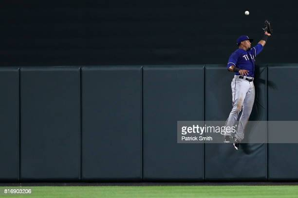 Carlos Gomez of the Texas Rangers cannot make a catch on a home run hit by Seth Smith of the Baltimore Orioles during the seventh inning at Oriole...