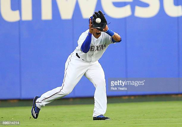 Carlos Gomez of the Texas Rangers catches a long fly ball to left field in the second inning against the Cleveland Indians at Globe Life Park in...