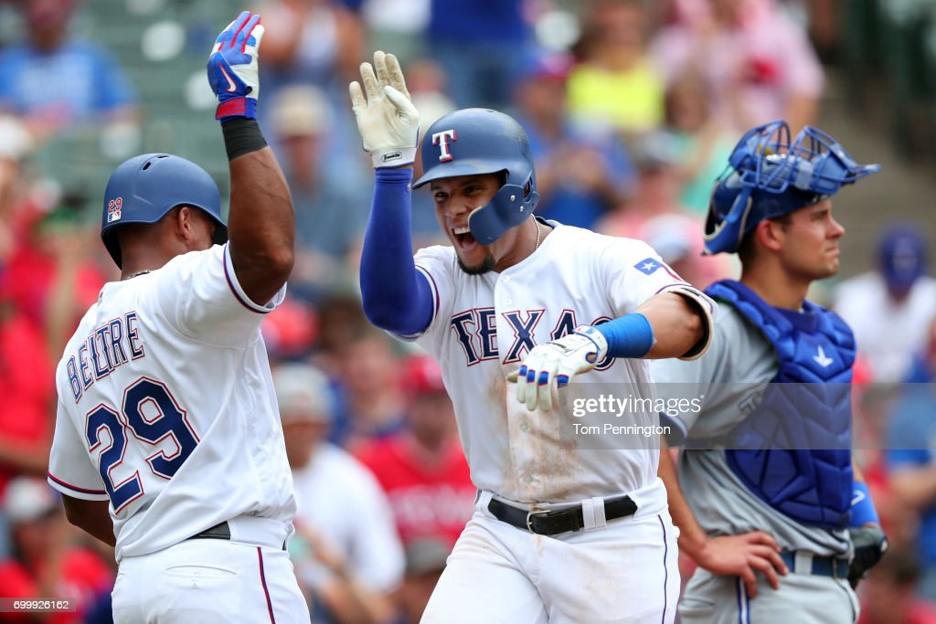 Carlos Gomez #14 of the Texas Rangers celebrates with Adrian Beltre #29 of the Texas Rangers after hitting a three run home run against the Toronto Blue Jays in the bottom of the third inning at Globe Life Park in Arlington on June 22, 2017 in Arlington, Texas.