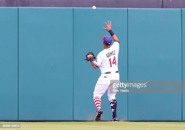 Carlos Gomez of the Texas Rangers chases down a fly ball deep to center field in the second inning against the Boston Red Sox at Globe Life Park in...
