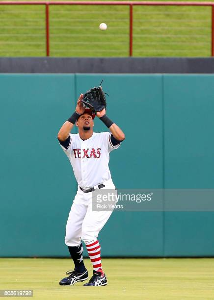Carlos Gomez of the Texas Rangers fields a fly ball in the second inning against the Boston Red Sox at Globe Life Park in Arlington on July 4 2017 in...