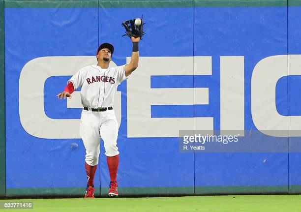 Carlos Gomez of the Texas Rangers fields a fly ball in the sixth inning against the Houston Astros at Globe Life Park in Arlington on August 12 2017...