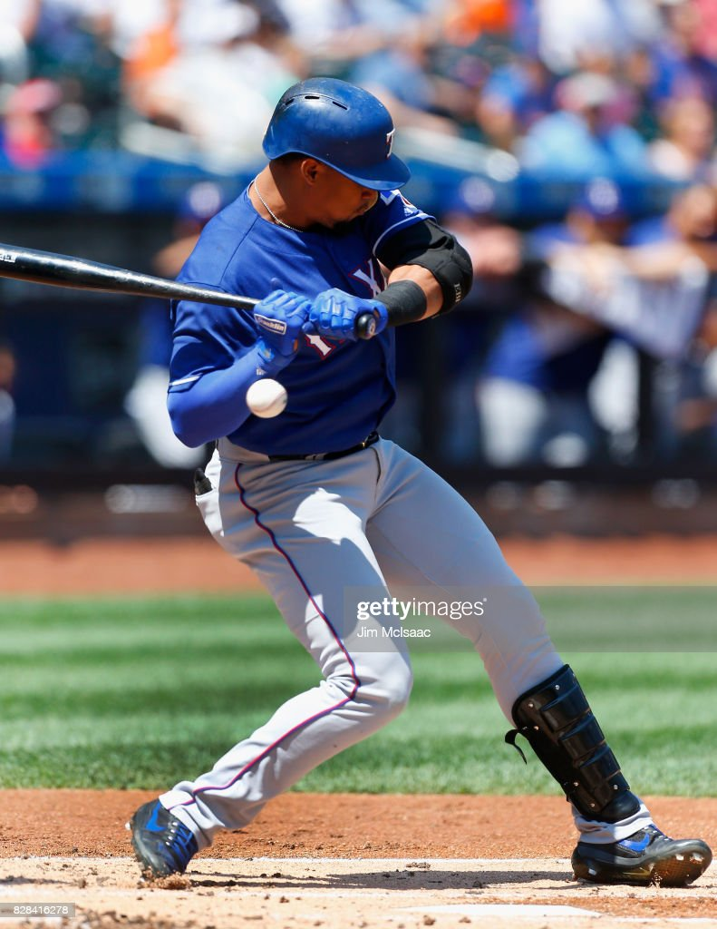 Carlos Gomez #14 of the Texas Rangers is hit by a pitch during the first inning against the New York Mets at Citi Field on August 9, 2017 in the Flushing neighborhood of the Queens borough of New York City.