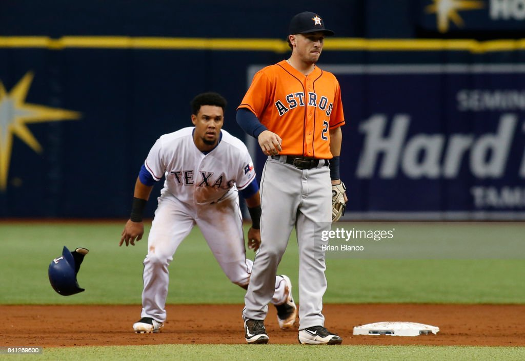 Carlos Gomez #14 of the Texas Rangers steals second base ahead of shortstop Alex Bregman #2 of the Houston Astros during the second inning of a game on August 31, 2017 at Tropicana Field in St. Petersburg, Florida.
