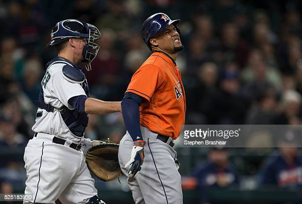 Carlos Gomez right of the Houston Astros reacts after being hit by a pitch thrown by Hisashi Iwakuma of the Seattle Mariners during the fourth inning...