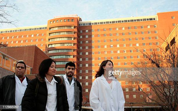 Carlos Gonzalez, Frances Calderon, Jorge Contreras and Patricia Burgos walk across the campus of the National Institutes of Health in Bethesda,...