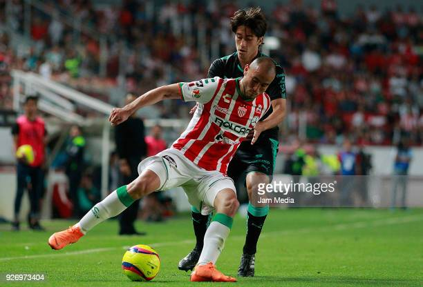 Carlos Gonzalez of Necaxa and Jose Abella of Santos fight for the ball during the 10th round match between Necaxa and Santos Laguna as part of the...