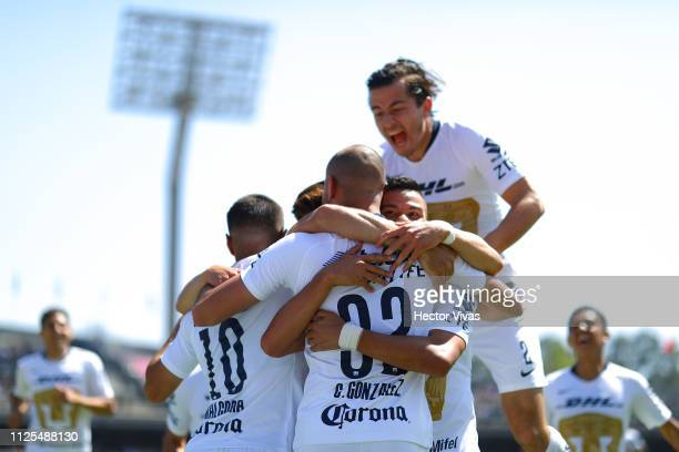 Carlos Gonzalez of Pumas celebrates with teammates after scoring the first goal of his team during the seventh round match between Pumas UNAM and...