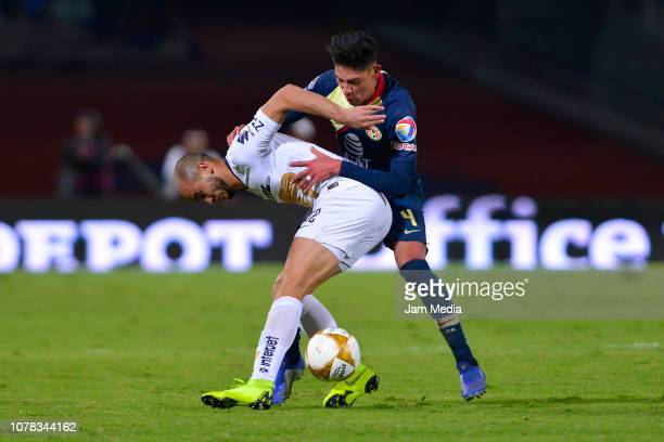 Carlos Gonzalez of Pumas fights for the ball with Edson Alvarez of America during the semifinal first leg match between Pumas UNAM and America as...