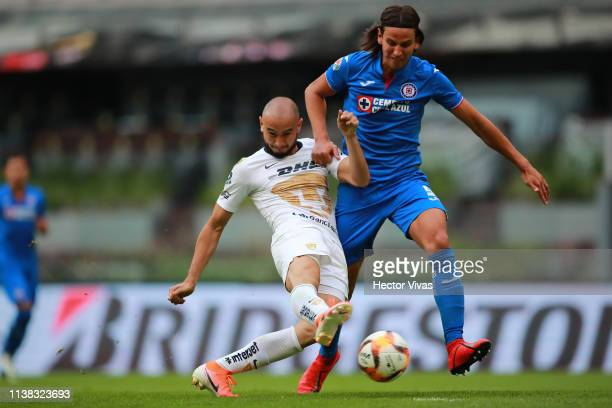 Carlos Gonzalez of Pumas struggles for the ball with Igor Lichnovsky of Cruz Azul during the 15th round match between Cruz Azul and Pumas UNAM as...