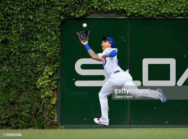 Carlos Gonzalez of the Chicago Cubs dives to make a catch in the seventh inning against the Los Angeles Angels at Wrigley Field on June 03, 2019 in...
