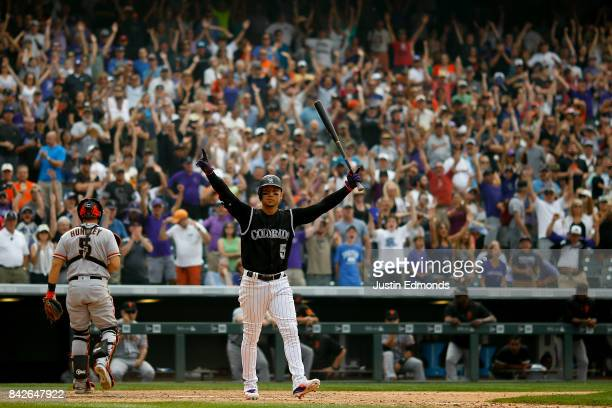 Carlos Gonzalez of the Colorado Rockies celebrates after walking in the ninth inning with the bases loaded that gave the Rockies the 43 victory as...