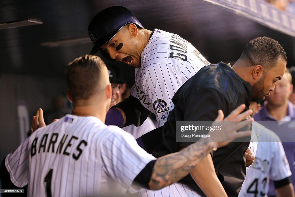 Carlos Gonzalez #5 of the Colorado Rockies celebrates his solo home run off of starting pitcher Chris Heston #53 of the San Francisco Giants with Wilin Rosario #20 and Brandon Barnes #1 of the Colorado Rockies to take a 1-0 lead in the first inning at Coors Field on September 4, 2015 in Denver, Colorado.