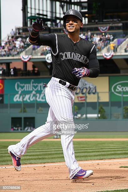 Carlos Gonzalez of the Colorado Rockies celebrates his solo home run off of James Shields of the San Diego Padres to take a 10 lead in the first...