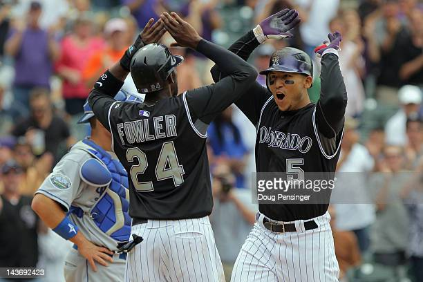 Carlos Gonzalez of the Colorado Rockies celebrates his two run home run with Dexter Fowler of the Colorado Rockies who scored on the play in the...