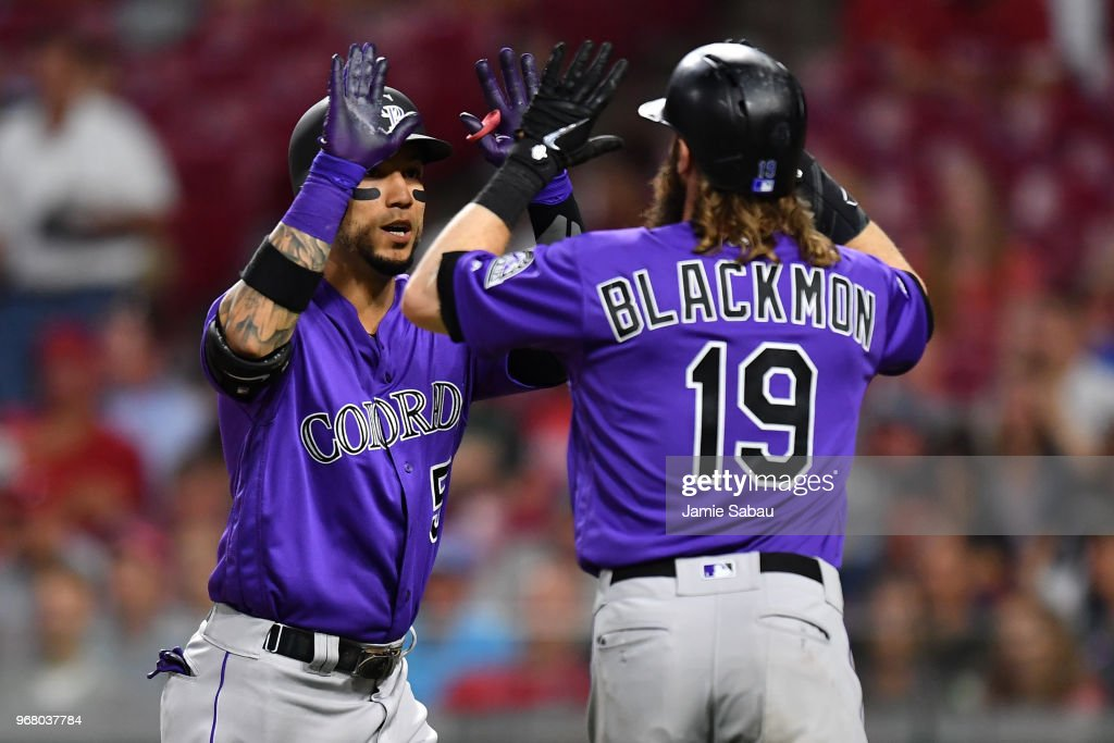 Carlos Gonzalez #5 of the Colorado Rockies celebrates with Charlie Blackmon #19 of the Colorado Rockies after hitting a three-run home run in the seventh inning against the Cincinnati Reds at Great American Ball Park on June 5, 2018 in Cincinnati, Ohio. Colorado defeated Cincinnati 9-6.