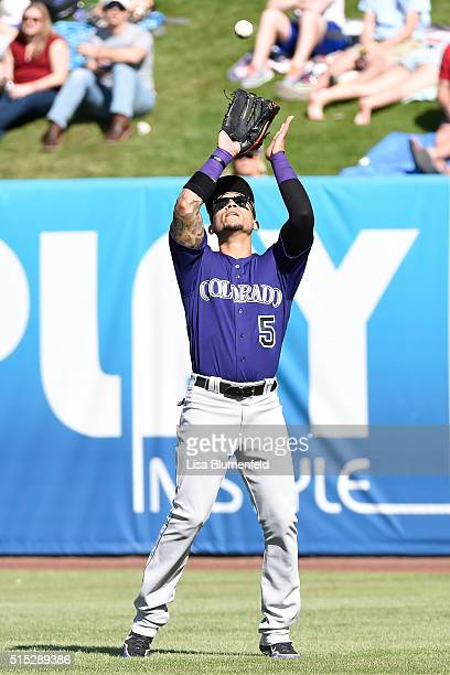 Carlos Gonzalez of the Colorado Rockies fields the ball against the Milwaukee Brewers on March 12 2016 in Phoenix Arizona