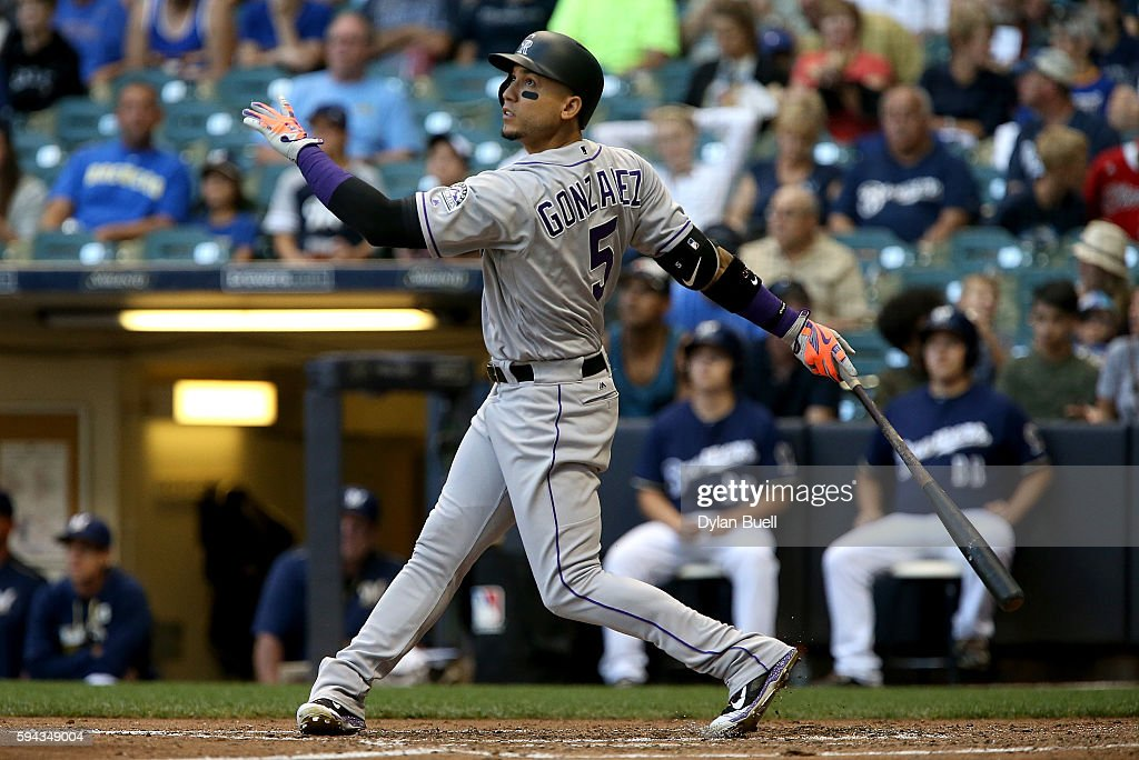 Carlos Gonzalez #5 of the Colorado Rockies flies out in the third inning against the Milwaukee Brewers at Miller Park on August 22, 2016 in Milwaukee, Wisconsin.