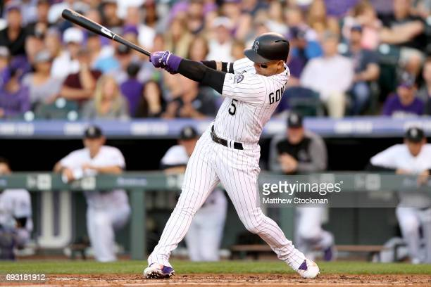 Carlos Gonzalez of the Colorado Rockies hits a 2 RBI home run in the third inning against the Cleveland Indians at Coors Field on June 6 2017 in...