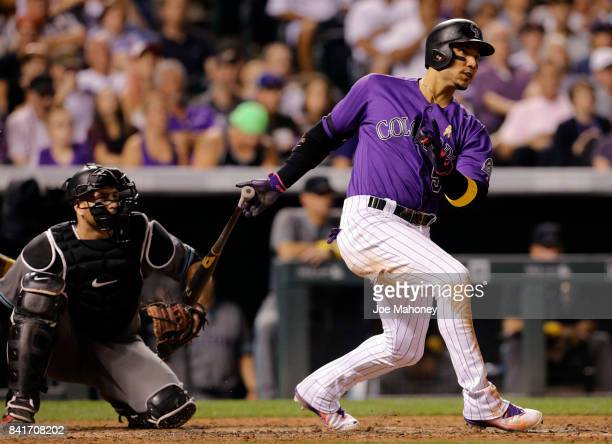 Carlos Gonzalez of the Colorado Rockies hits a double to score Ian Desmond of the Colorado Rockies in the sixth inning at Coors Field on September 1...