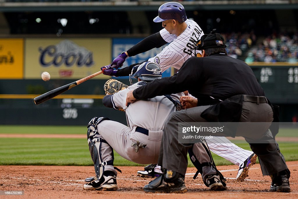 Carlos Gonzalez #5 of the Colorado Rockies hits a sacrifice fly during the first inning against the New York Yankees at Coors Field on May 9, 2013 in Denver, Colorado.