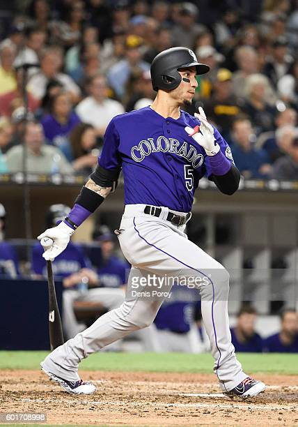 Carlos Gonzalez of the Colorado Rockies hits a single during the sixth inning of a baseball game against the San Diego Padres at PETCO Park on...