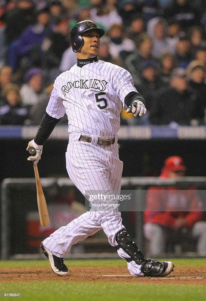 Carlos Gonzalez #5 of the Colorado Rockies hits a solo home run against the Philadelphia Phillies in the bottom of the fourth inning in Game Three of the NLDS during the 2009 MLB Playoffs at Coors Field on October 11, 2009 in Denver, Colorado.