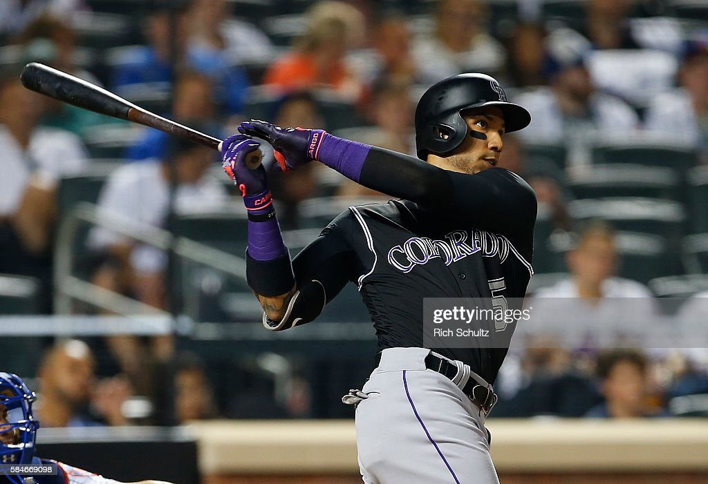 Carlos Gonzalez #5 of the Colorado Rockies hits a three run home run against the New York Mets in the ninth inning of a game at Citi Field on July 29, 2016 in the Flushing neighborhood of the Queens borough of New York City.