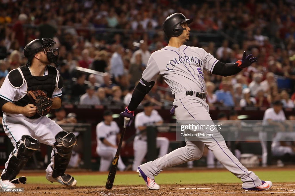 Carlos Gonzalez #5 of the Colorado Rockies hits a two run home run against the Arizona Diamondbacks during the third inning of the MLB game at Chase Field on September 12, 2017 in Phoenix, Arizona.