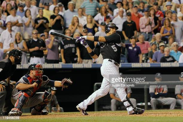 Carlos Gonzalez of the Colorado Rockies hits a walkoff RBI single in the bottom of the ninth inning against the Atlanta Braves at Coors Field on July...