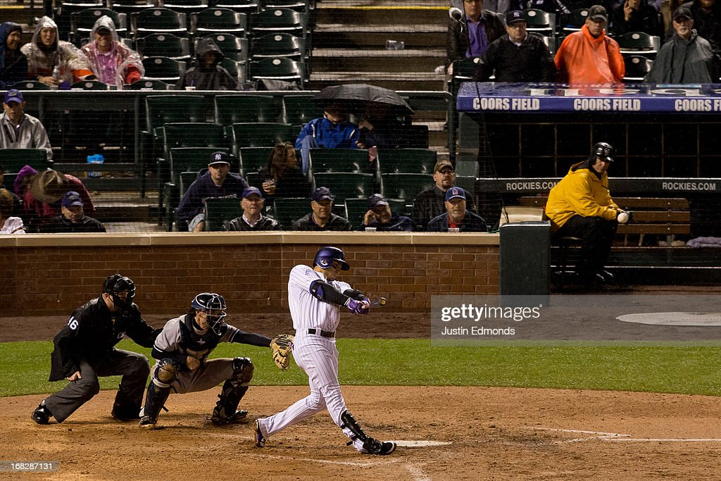 Carlos Gonzalez #5 of the Colorado Rockies hits the game winning two-run home run during sixth inning against the New York Yankees at Coors Field on May 7, 2013 in Denver, Colorado. The Rockies defeated the Yankees 2-0.