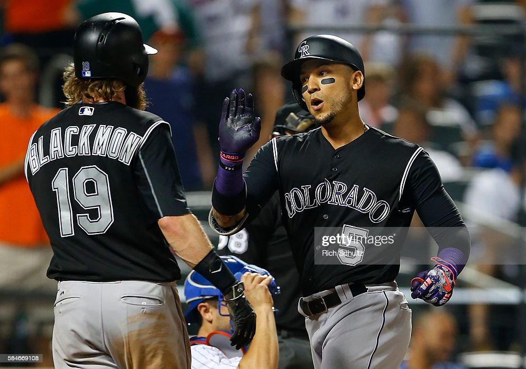 Carlos Gonzalez #5 of the Colorado Rockies is congratulated by Charlie Blackmon #19 after he hit a three run home run against the New York Mets in the ninth inning of a game at Citi Field on July 29, 2016 in the Flushing neighborhood of the Queens borough of New York City.