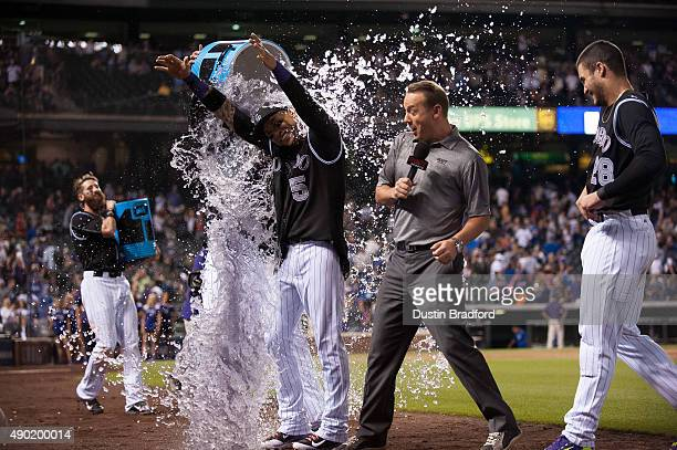 Carlos Gonzalez of the Colorado Rockies is drenched by a teammate after hitting a walkoff 2run home run to put the Rockies ahead of the Dodgers 86 at...