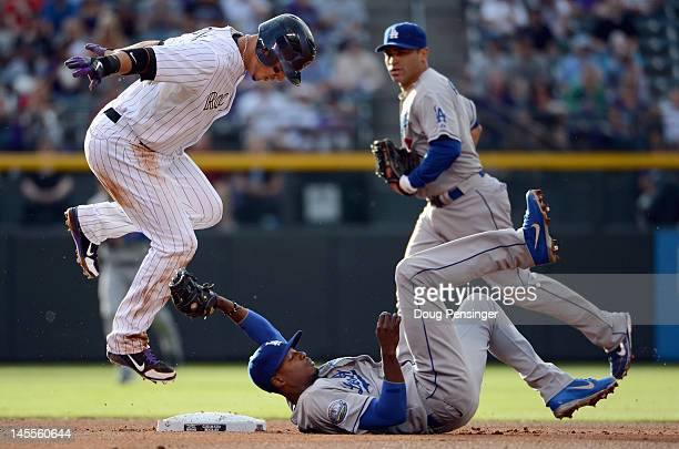 Carlos Gonzalez of the Colorado Rockies is tagged out at second base by shortstop Dee Gordon of the Los Angeles Dodgers to end the first inning at...
